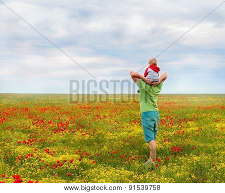 Dad and son in the field
