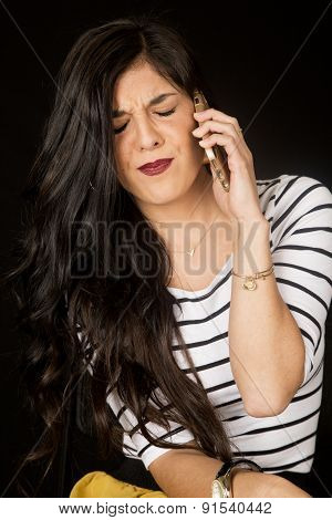 Pretty Brunette Talking On Her Cell Phone With Her Eyes Closed