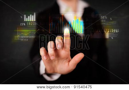 Business woman touching colorful charts and diagrams
