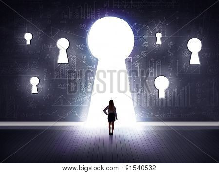 Successful businessman looking through keyhole