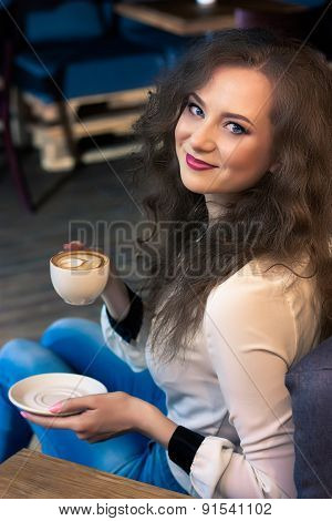 Beautiful girl with coffee