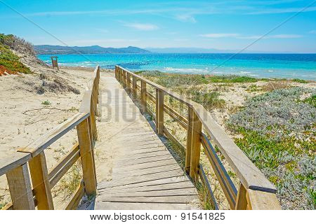 Wooden Boardwalk To The Beach In Capo Testa
