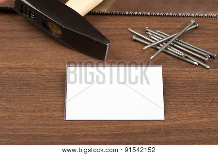 Hammer with badge and nails on table