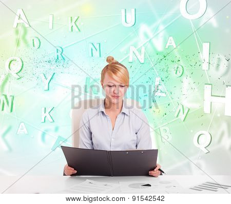 Business woman at white desk with green word cloud