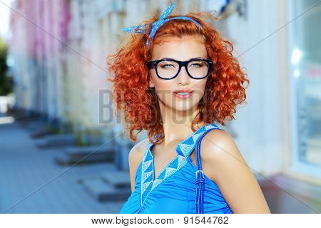 Pretty pin-up girl walking in the city. Beauty, fashion.