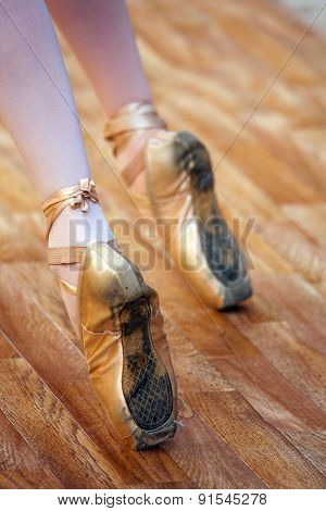 A Ballet Fragment With Little Girls Legs On Pointes