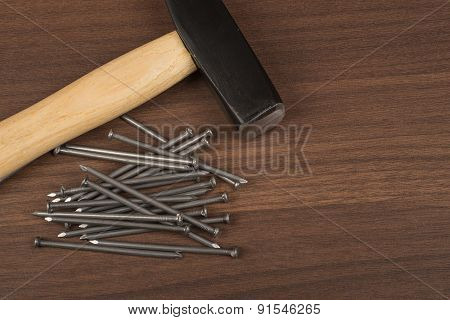 Hammer with big pile of nails