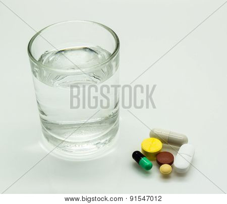 Medicine, Capsule, Pill And Glass Of Water