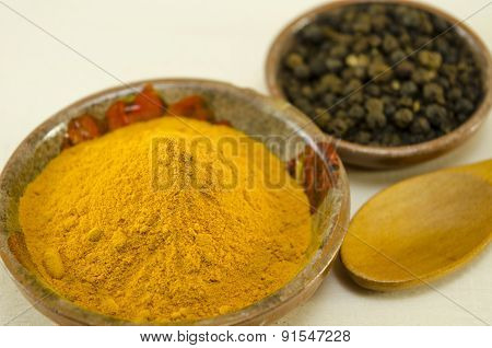 Curry And Pepper On A Table
