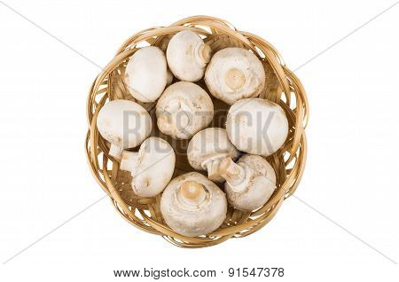 Basket Wicker With Raw Champignons Isolated On White