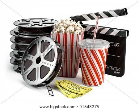 Cinema concept: Clapper board, film reels, popcorn, cola, cinema tickets