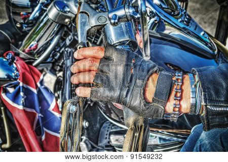 Biker Hand With Glove On The Handlebar