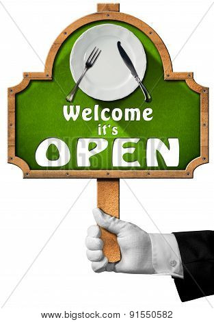 Welcome It Is Open - Sign With Hand Of Waiter