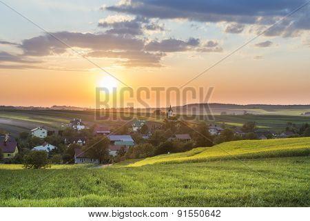 Sundown Over Village On Polish Countryside