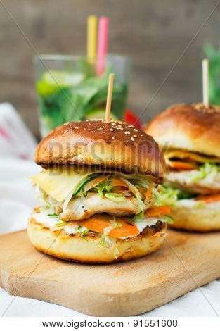 Burgers With Chicken And Stuffed  Juicy With Cucumber, Carrots And Cabbage