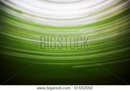 Abstract background: circular panning landscape on green tones
