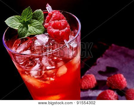 Cold red drink  with berry and green mint leaf. Top view.