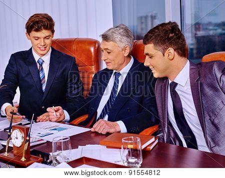 Happy businessman  speaking in office. Three men.