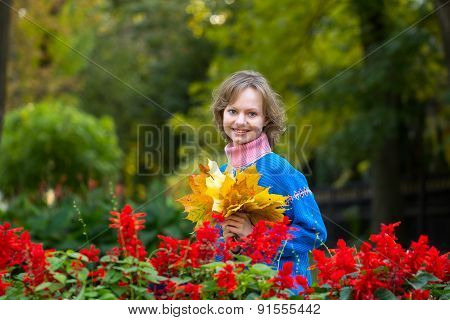 The Young Girl With A Bouquet From Leaves