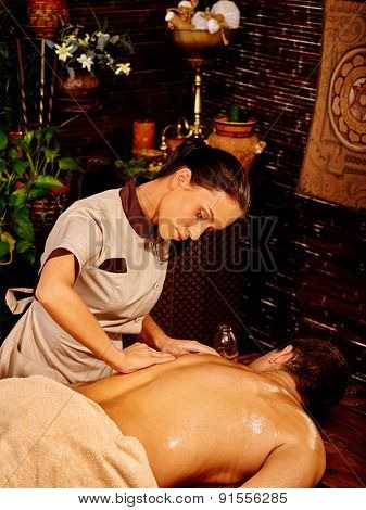 Man  having oil Ayurveda in luxury spa treatment.