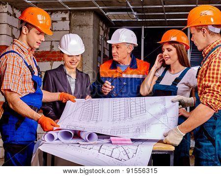 Business group people in builder helmet working indoor.