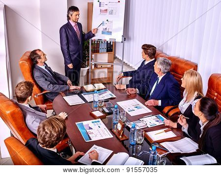 Happy group business people with chart in office. Staff training. Top view