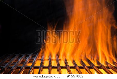 Cast-iron grate with fire flames, ready to add some meat.