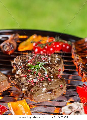 Delicious meats on garden grill, barbecue time.