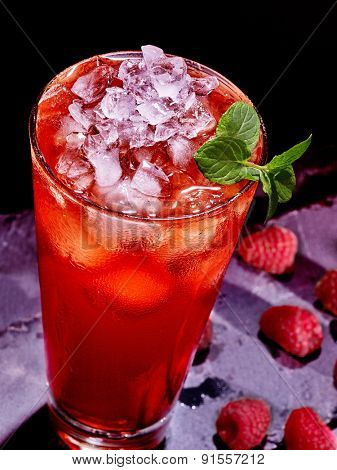 Cold red drink  with group berry and green mint leaf. Top view.