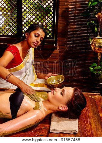 Young caucasian woman having body Ayurveda spa massage.
