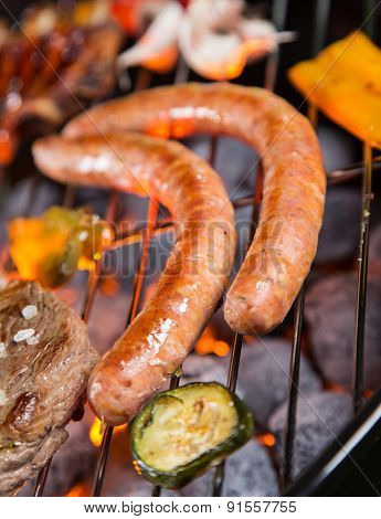 Grilled sausages on the grill, close-up.