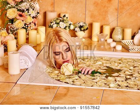 Woman with close up relaxing at water spa.