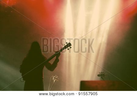 Guitarist silhouette in smoke during concert  - retro style photograph