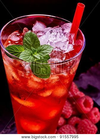 Cold straw red drink  with berry and mint leaf. Top view.