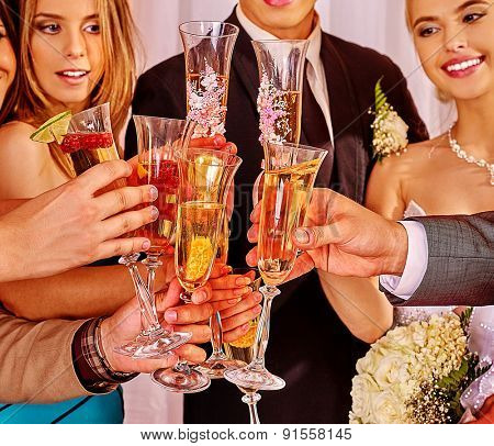 Group people at wedding table drinking champagne.