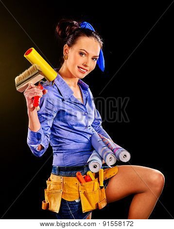 Builder woman with wallpaper. Fashion studio shoton on black background.
