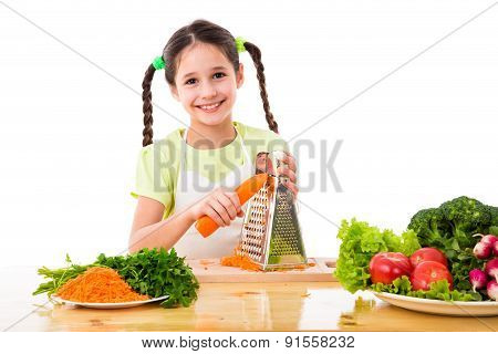 Girl grate the carrots