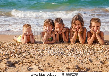 Five kids on the beach