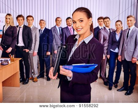 Happy group business people together  in office. Girl in foreground.