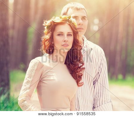 Portrait of beautiful dreamy couple in the forest in bright sunny day, wedding celebration, romantic relationship, love and fashion concept