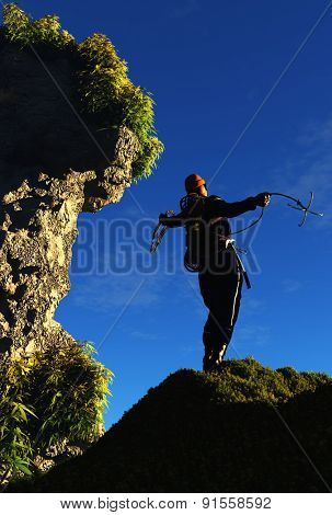 Climber throwing the hook in the mountains.