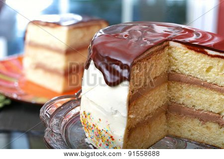 White layer cake with chocolate icing