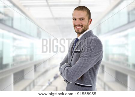 young happy businessman portrait at the office