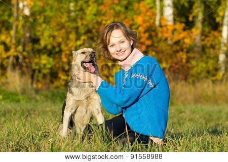 The Young Girl With A Dog Outdoors