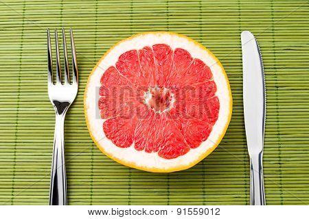 Grapefruit Between Fork And Knife