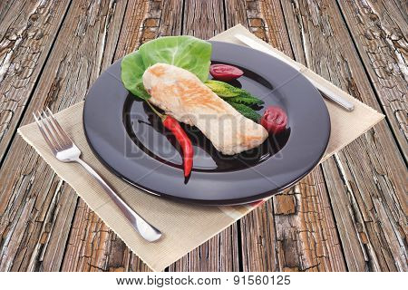 fresh roast turkey meat fillet steak served with vegetables on plate over wooden table