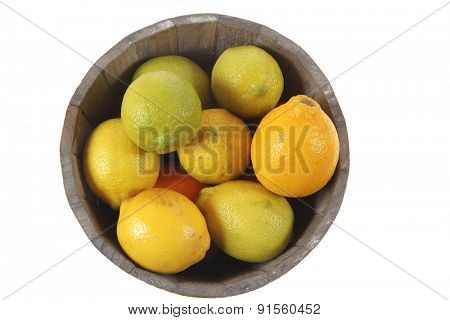 harvest of fresh raw lemon in wooden bucket isolated over white background