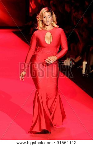 NEW YORK-FEB 12: Actress Dascha Polanco wears Michael Costello at Go Red for Women-The Heart Truth Red Dress Collection at Mercedes-Benz Fashion Week on February 12, 2015 in New York City.