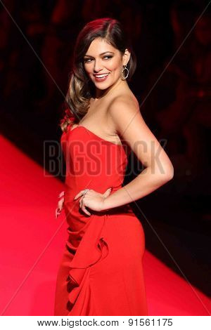 NEW YORK-FEB 12: Bethany Mota wears Badgely Mischka at Go Red for Women-The Heart Truth Red Dress Collection at Mercedes-Benz Fashion Week at Lincoln Center on February 12, 2014 in New York City.