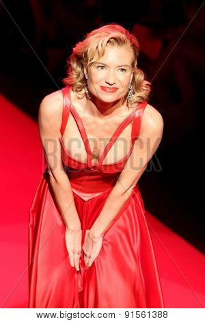 NEW YORK-FEB 12: Fitness entrepreneur Tracy Anderson wears Ina Soltani at Go Red for Women-The Heart Truth Red Dress Collection at Mercedes-Benz Fashion Week on February 12, 2014 in New York City.